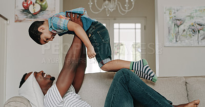 Buy stock photo Shot of a happy father and son playing and spending time together at home