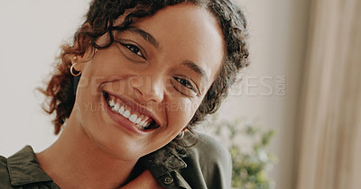 Buy stock photo Portrait of an attractive young woman feeling cheerful and confident while spending the day at home