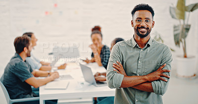Buy stock photo Portrait of a confident young businessman with his colleagues having a meeting in the background