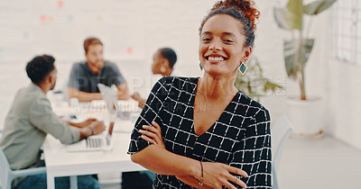Buy stock photo Portrait of a confident young businesswoman with her colleagues having a meeting in the background