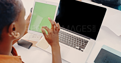 Buy stock photo Cropped shot of an unrecognizable businesswoman using her laptop at her desk