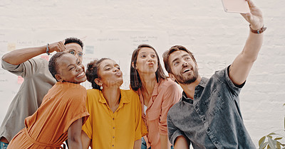 Buy stock photo Shot of a group of young designers taking a selfie together