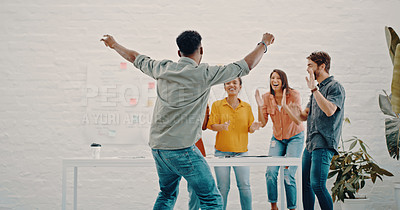 Buy stock photo Cropped shot of a group of cheerful businesspeople celebrating in the office
