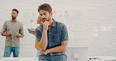 Buy stock photo Cropped shot of a man looking thoughtful while at the office