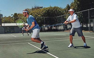 Buy stock photo Full length shot of two handsome sportsmen using resistant bands during a tennis training session during the day