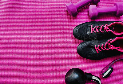 Buy stock photo High angle shot of a group of workout essentials lying on top of a pink background  inside of a studio