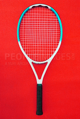 Buy stock photo High angle shot of a single tennis racket placed on a red background inside of a studio