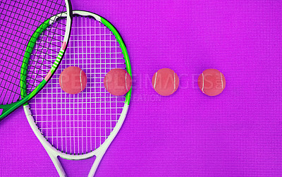 Buy stock photo High angle shot of tennis essentials placed on top of a purple background inside of a studio