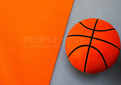 Buy stock photo High angle shot of a single basket ball placed on top of a colourful background inside of a studio