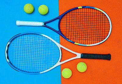 Buy stock photo High angle shot of tennis essentials placed on top of a colourful background inside of a studio