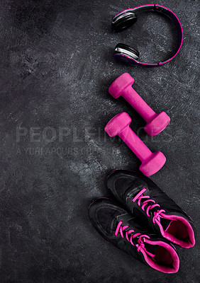 Buy stock photo High angle shot of a group of workout essentials lying on top of a dark background  inside of a studio