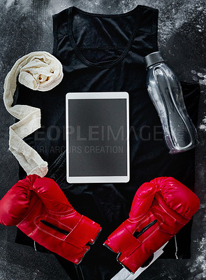 Buy stock photo High angle shot of boxing essentials placed on top of a dark background inside of a studio