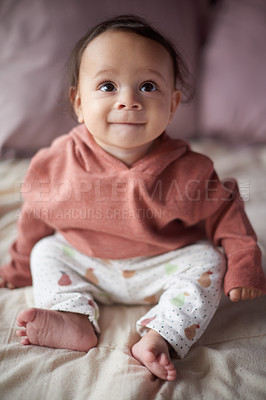 Buy stock photo Full length shot of an adorable little boy sitting on  a bed at home