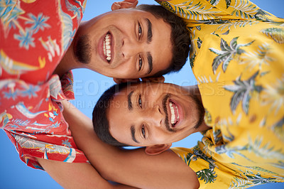Buy stock photo Low angle portrait of a young gay couple bonding together during a day out on the beach