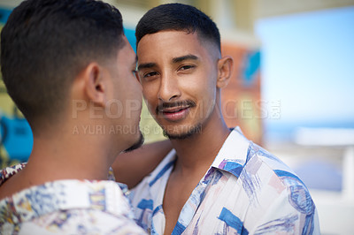 Buy stock photo Cropped portrait of a handsome young man bonding with his boyfriend during a day out by the beach