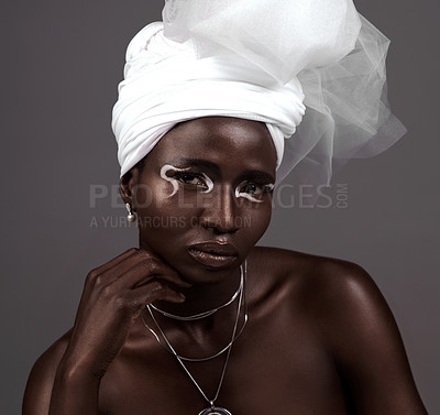 Buy stock photo Studio portrait of an attractive young woman posing in traditional African attire against a grey background