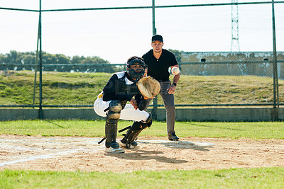 Buy stock photo Full length shot of a young baseball player waiting to catch a ball during a match on the field