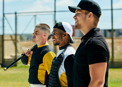 Buy stock photo Cropped shot of three handsome young baseball players smiling while standing on the field during the day