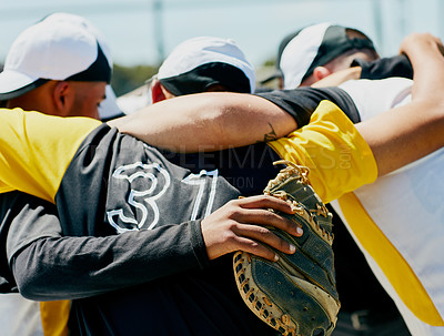 Buy stock photo Cropped shot of a team of unrecognizable baseball players standing together in a huddle on the field