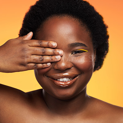Buy stock photo Studio shot of a beautiful young woman posing against an orange background