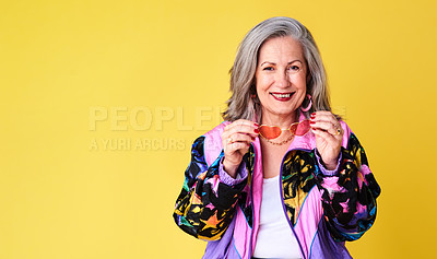 Buy stock photo Portrait of a confident and stylish senior woman posing against a yellow background