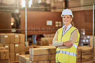 Buy stock photo Cropped portrait of an attractive mature supervisor wearing safety gear and standing with her arms folded in a warehouse