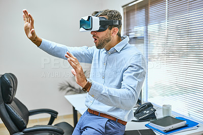 Buy stock photo Cropped shot of a businessman wearing a virtual reality headset in the office