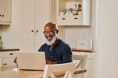 Buy stock photo Cropped shot of a senior man using a laptop while relaxing at home