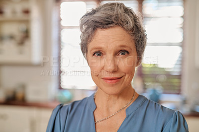 Buy stock photo Portrait of an attractive and happy mature woman at home