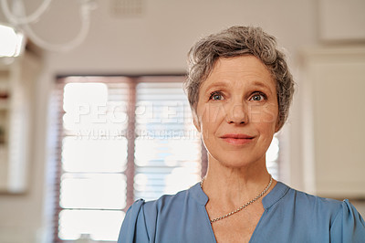 Buy stock photo Cropped shot of an attractive mature woman at home