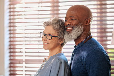 Buy stock photo Cropped shot of an affectionate and happy mature couple spending time together at home