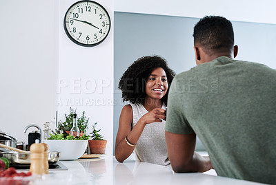 Buy stock photo Cropped shot of a happy young couple relaxing and spending time together at home