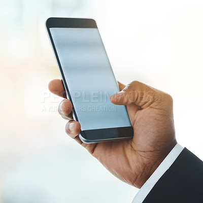Buy stock photo Closeup shot of an unrecognizable businessman using a cellphone in an office