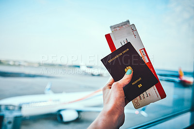 Buy stock photo Cropped shot of an unrecognizable woman holding up her passport and plane ticket before boarding her aircraft