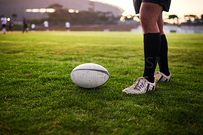 Buy stock photo Cropped shot of an unrecognizable sportsman standing alone during rugby practice in a sports club
