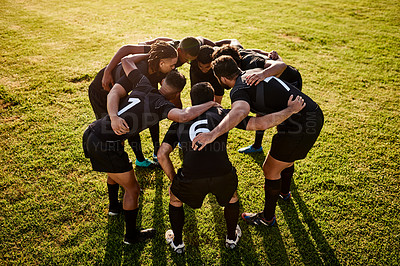 Buy stock photo Full length shot of a diverse group of sportsmen huddled together before playing rugby during the day