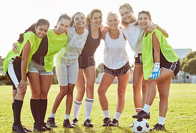 Buy stock photo Full length shot of a team of young female soccer players posing together outdoors on the filed