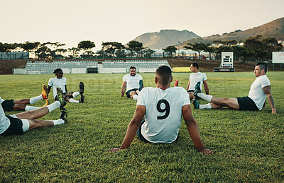 Buy stock photo Cropped shot of a group of young rugby players training on the field during the day