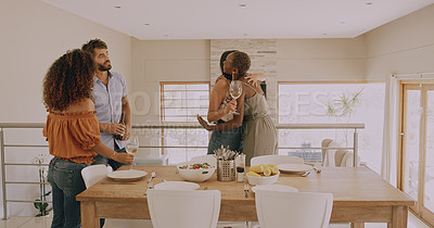 Buy stock photo Shot of a young woman greeting her friends after arriving at lunch party