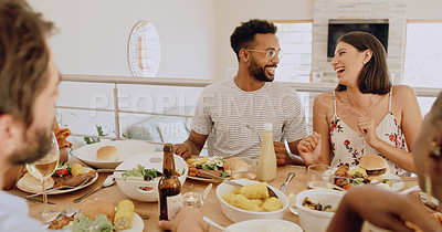 Buy stock photo Shot of young friends getting together for lunch at home
