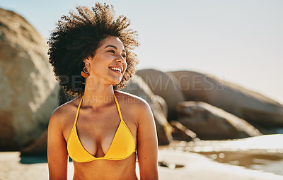 Buy stock photo Cropped shot of an attractive young woman enjoying a day out on the beach alone