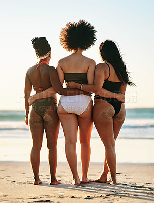 Buy stock photo Full length shot of an unrecognizable group of friends standing together during a day out on the beach
