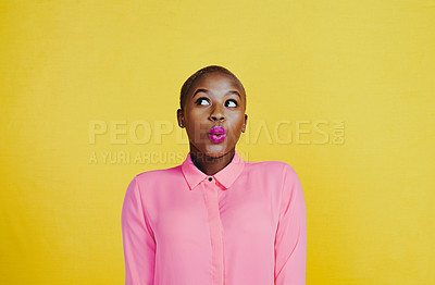 Buy stock photo Cropped shot of an attractive young woman whistling and feeling curious against a yellow background