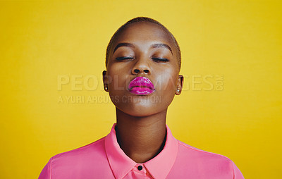 Buy stock photo Cropped shot of an attractive young woman posing with her eyes closed in studio against a yellow background