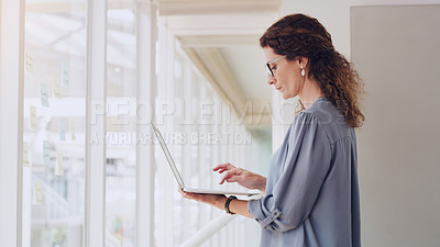 Buy stock photo Shot of a mature businesswoman using a laptop in an office