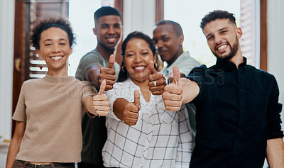 Buy stock photo Shot of a group of young businesspeople showing thumbs up in a modern office