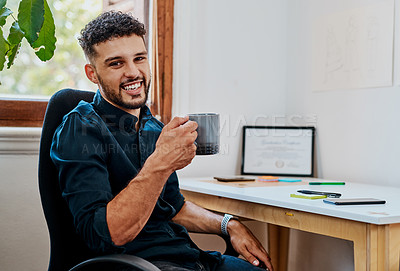 Buy stock photo Shot of a young businessman having a coffee break at his desk in a modern office