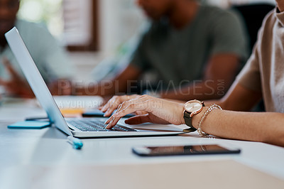 Buy stock photo Cropped shot of a businesswoman using a computer in a modern office