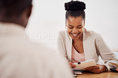 Buy stock photo Shot of a young businesswoman having a meeting with her colleague in an office