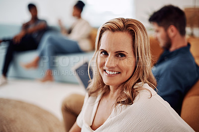 Buy stock photo Cropped portrait of an attractive young businesswoman sitting with a male colleague in the office